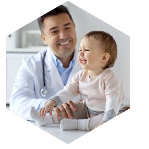 happy-doctor-or-pediatrician-with-baby-at-clinic-PAX9NLY